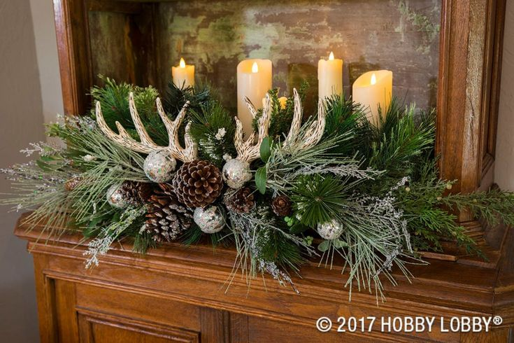 For Christmas arrangements that are festive and rustic, gather floral picks, ornaments, pinecones, faux antlers and candles!