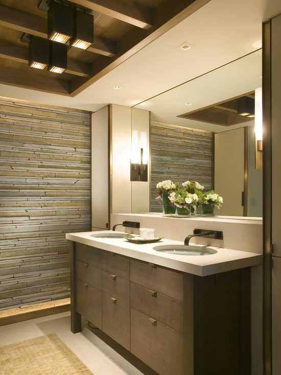 Rocky Mountain Hardware cabinetry featured on Houzz - Example of a trendy bathroom design in Other with an undermount sink, flat-panel cabinets, dark wood cabinets and beige tile