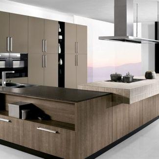 Petra - Arredo3  Una cucina che predilige l'organizzazione degli spazi, grazie alla disposizione funzionale delle diverse zone lavoro: lavaggio-cottura-dispensa.