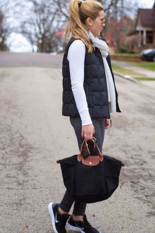 I like how this active attire is dressed up with the vest, scarf, and bag. Image…