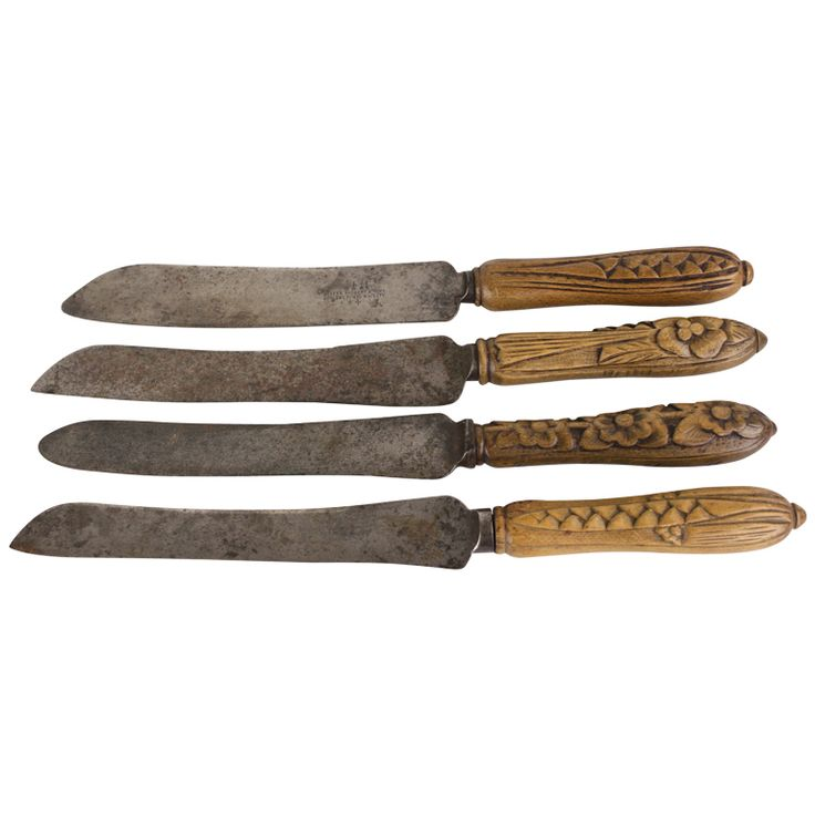 Set Of Four Antique English Bread Knives, Carved Handles | From a unique collection of antique and modern individual pieces at http://www.1stdibs.com/furniture/dinnerware/dinnerware-individual-pieces/