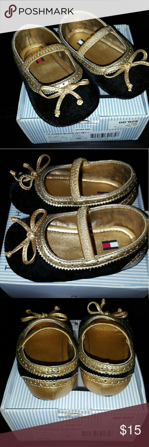 Black & Gold Tommy Hilfiger Size 3 Baby Shoes Lil Karen Velvet Black baby shoes by Tommy Hilfiger. It is in size 3. Comes with box. Gently used. Tommy Hilfiger Shoes Baby & Walker