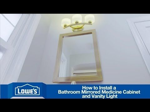 install a mirrored medicine cabinet and vanity light