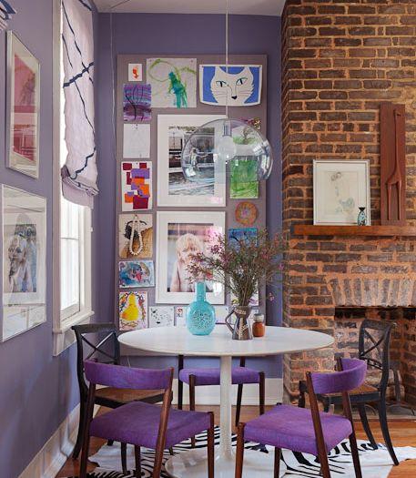 Fun purple chairs and kids art gallery wall