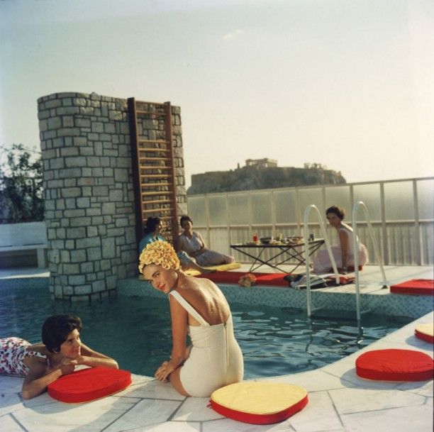 'Penthouse Pool'  Open Edition or Limited Edition Estate Stamped Ctype Print (edition size 1/150).  Young women by the Canellopoulos penthouse pool, Athens, July 1961. (Photo by Slim Aarons) Available to order in various sizes & frames from GALERIEPRINTS.com