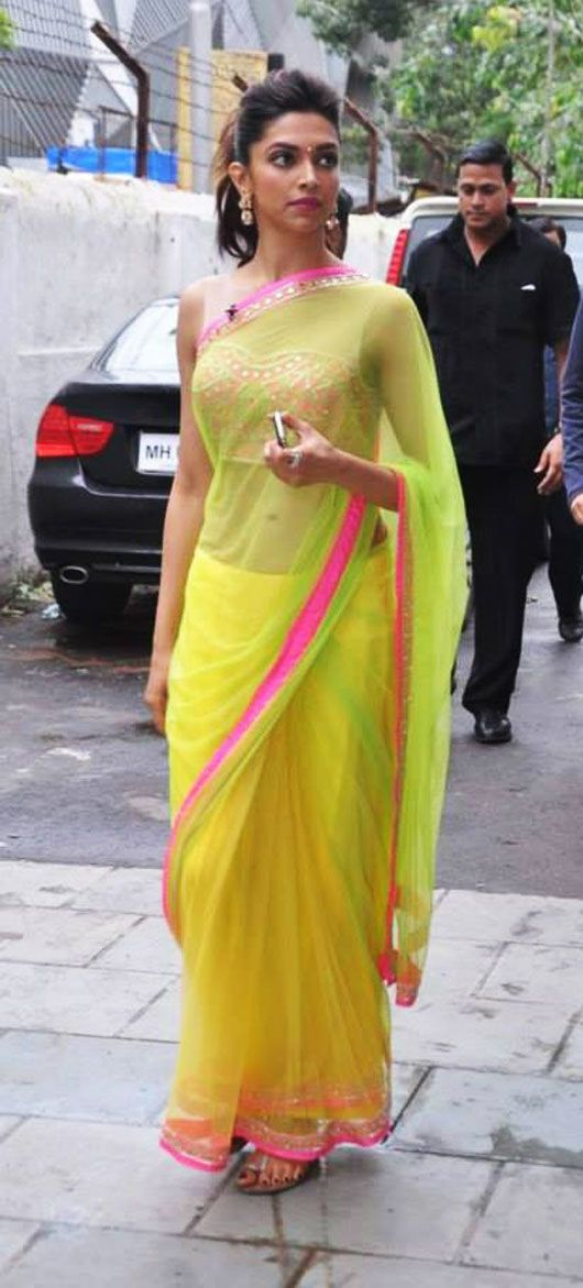 Deepika Padukone wears B'ful neon Arpita Mehta Saree and Blouse http://arpitamehta.in/ https://www.facebook.com/pages/Arpita-Mehta/482620718455205 w/ Earrings by http://www.amrapalijewels.com/