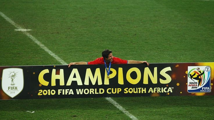 JOHANNESBURG, SOUTH AFRICA - JULY 11: Joan Capdevila of Spain poses with the winners board after the 2010 FIFA World Cup South Africa Final match between Netherlands and Spain at Soccer City Stadium on July 11, 2010 in Johannesburg, South Africa. (Photo by Quin Rooney - FIFA/FIFA via Getty Images)