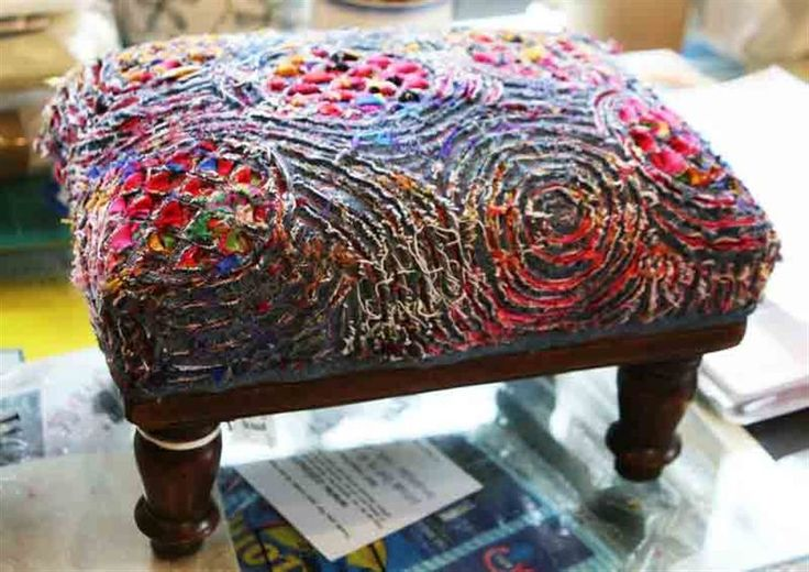 "Can't find the original post - but this seems to be by FAY MAXELL - Broken link to somewhere on the colouricious.com site. Footstool (good size for a project!) done in faux chenille with stitching in curves and circles and a cross-hatch. Note that when the curve syncs up with the straight grain of the fabric - as at center front of photo - you get long, ragged threads raveling off rather than the ""bloom"" you get on the true bias."
