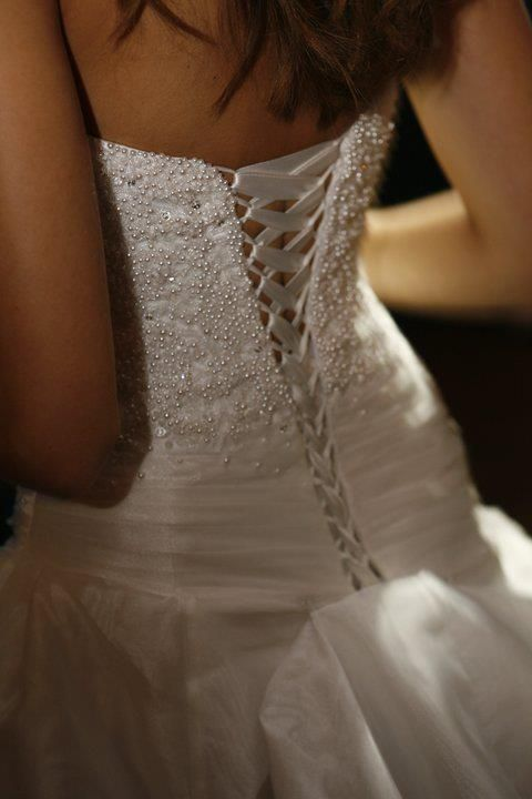Finally it the zipper replaced on my wedding dress with a corset closure! (This is not my dress)