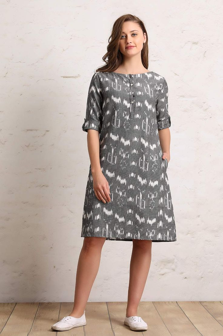Straight short dress with buttoned sleeves