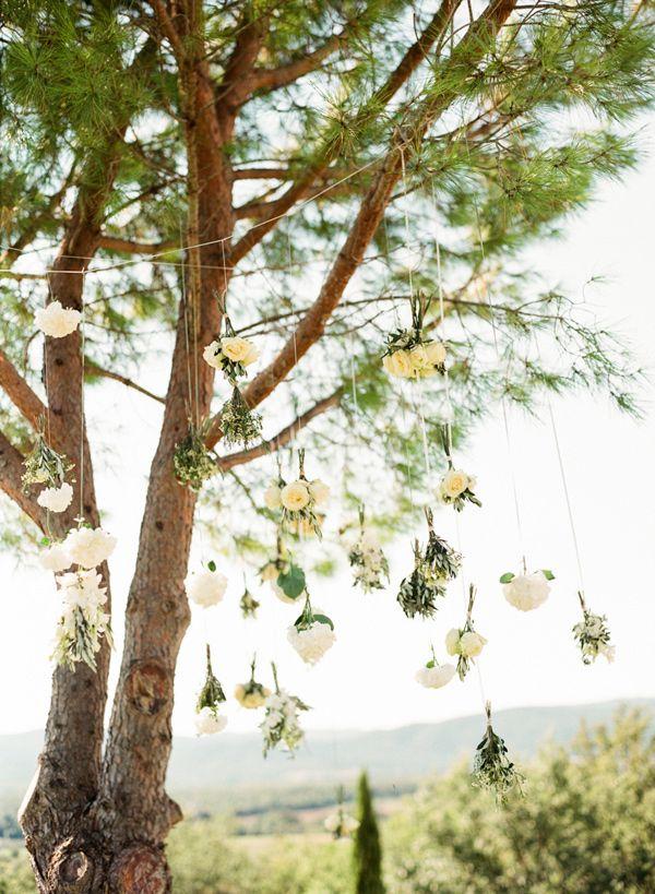hanging ceremony flowers - photo by Lindsay Madden Photography http://ruffledblog.com/family-style-destination-wedding-in-tuscany