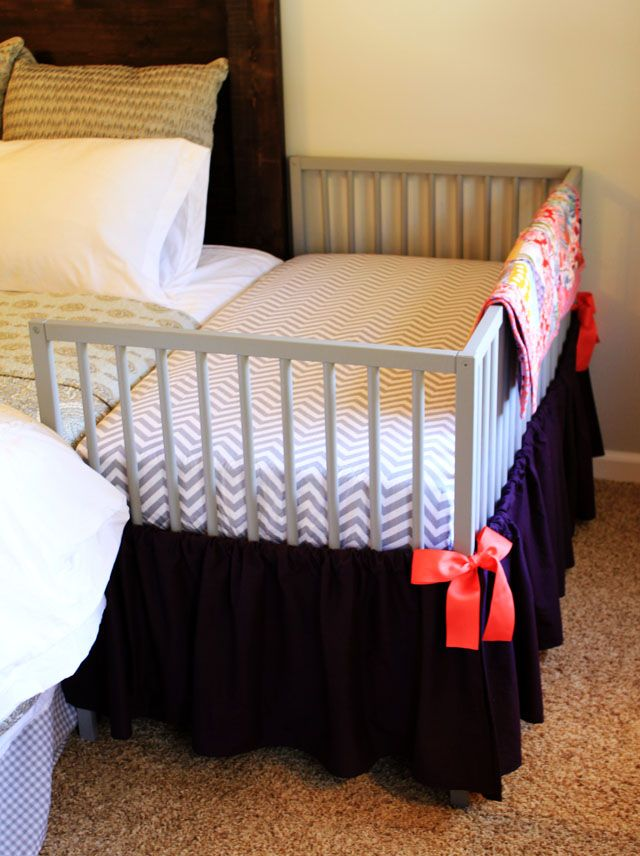 DIY Co-sleeper {IMPORTANT FOR SAFETY: The crib is securely attached to the bed frame with nylon straps to ensure that no gap can form between the two mattresses.)