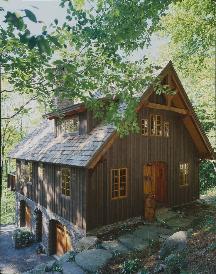 Walkout Basement House Plans for a Rustic Exterior with a Wood Window Frame and Timberpeg Carriage House by Timberpeg