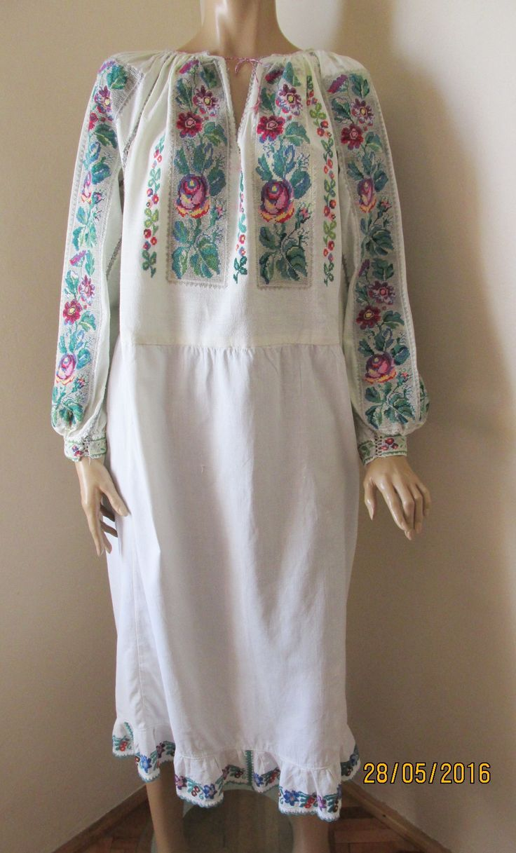 Gorgeous antique Romanian traditional blouse dress from Muscel area. The dress is hand embroidered with multicolored cotton thread on white linen. www.greatblouses.com