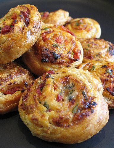 Sun-Dried Tomato, Parmesan  1 packet puff pastry, 500g, all butter  2-3 cups of grated fresh Parmesan cheese  1 cup sun-dried tomatoes, drained from olive oil and chopped  Fresh basil leaves, torn up  Chilli flakes to taste  1 egg, beaten, for glazing