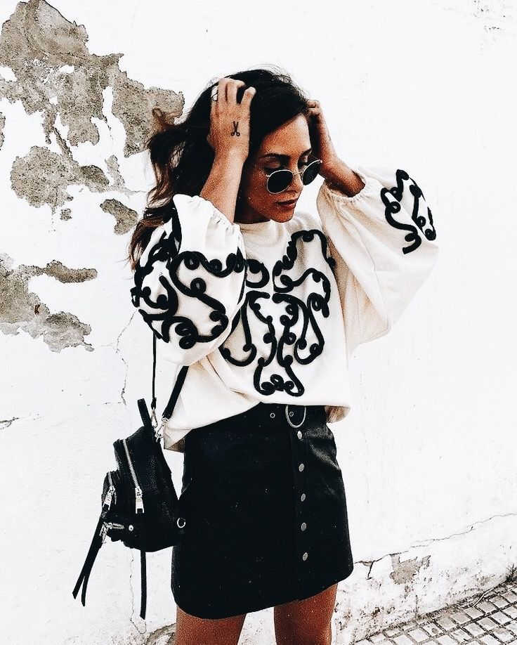 Black and white sweater. Black button down skirt.  Street style, street fashion, best street style, OOTD, OOTD Inspo, street style stalking, outfit ideas, what to wear now, Fashion Bloggers, Style, Seasonal Style, Outfit Inspiration, Trends, Looks, Outfits.