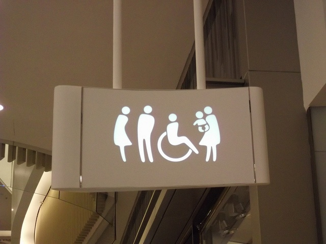 Redesign of toilet sign in Hong Kong shopping centre - desperate for a pee? by soshanau, via Flickr