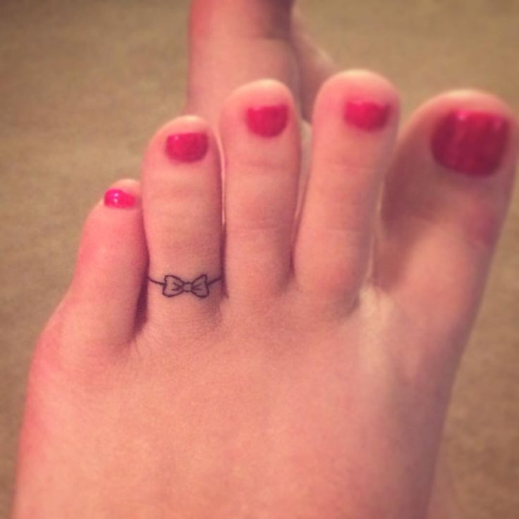 Bow toe ring tattoo
