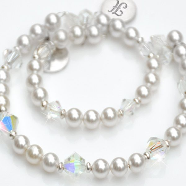 Enchanting matching Mother & Child bracelets crafted in sterling silver with lustrous Swarovski pearl and sparkling crystal.