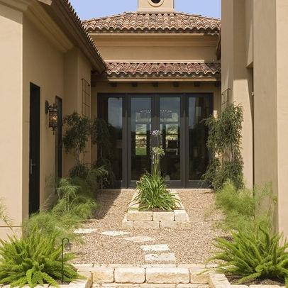 Mediterranean home mansard roof design ideas pictures for Courtyard renovation ideas