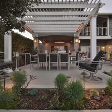 Transitional Outdoor Dining Area With White Pergola