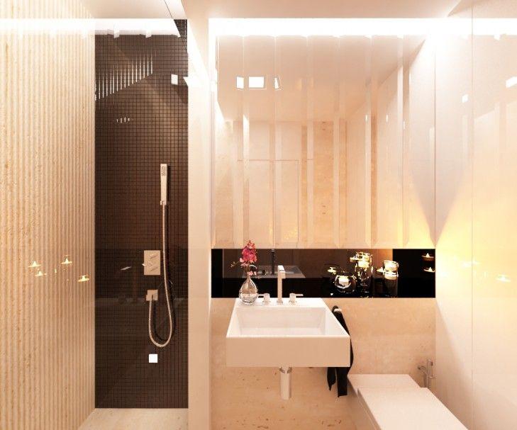 Wystrój wnętrz eleganckiej łazienki w rezydencji. Jasne ściany, wykończone kamieniem kontrastują z czarną szybą nad umywalką oraz mozaiką z połyskiem.