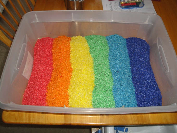 rice dyed with Wilton food gel (dye found at Michaels). Mix each batch of uncooked rice with a few squirts of purell( the alcohol makes the food dye stick to the rice better) and some food dye, let it dry for a bit on some newspaper and pour it into a container for kids to play inSensory Table