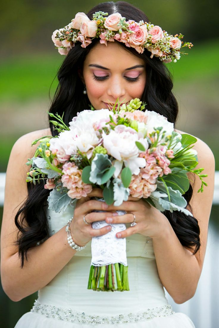 Pastel palette bridal bouquet with peonies, tuberose, spray roses, seeded eucalyptus, dusty miller and freesia.