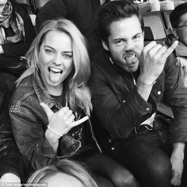 Margot Robbie and boyfriend Tom Ackerley enjoy a sports game #dailymail