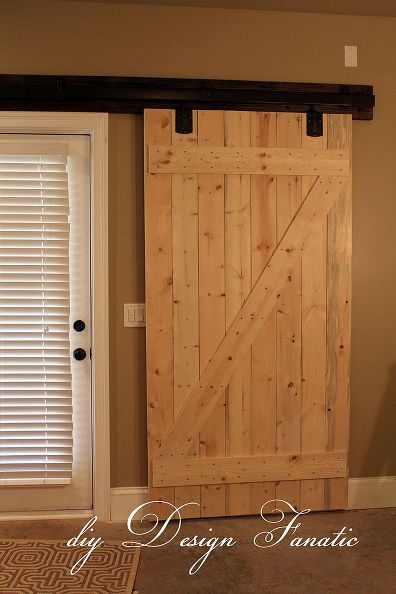 Barn doors built to go over sliding glass doors in a basement.  Gives privacy and security.