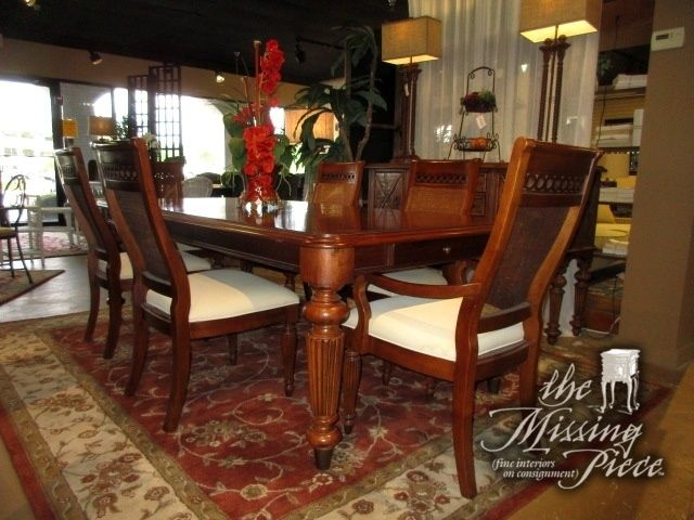 "Beautiful lexington dining table with two side drawers in a warm medium finish & six chairs. The chairs have a circle pattern cutout at the top with cane backs. Perfect transitional style set! 76""L x 45""W;(2)18""Lfs."
