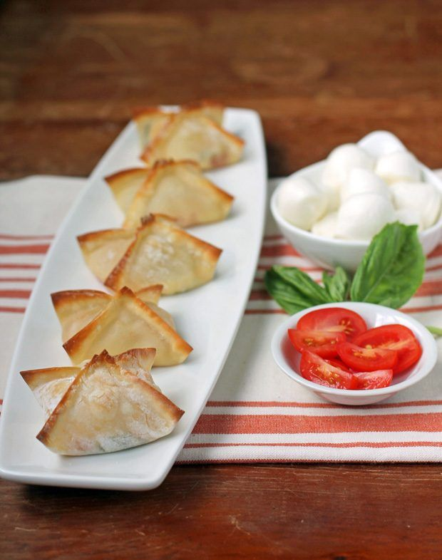 These Caprese Wonton Bites are the best healthy four-ingredient appetizer or snack. Easy and delicious and just 44 calories or 1 Weight Watchers SmartPoint! www.emilybites.com