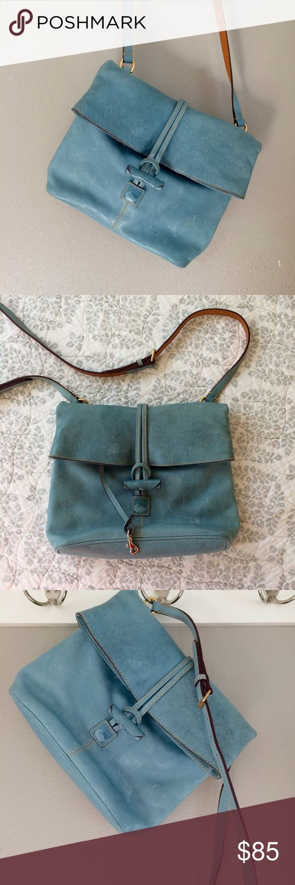 OS Donney & Bourke Cross Body Bag OS Donney & Bourke Cross Body Bag. Sky blue with emerald green and red lining. Fold over Top with plenty of pockets inside and out. My favorite size for travel and everyday. Very good condition, some very minor scuffs in leather. Bundle for additional discounts and seller offers. Dooney & Bourke Bags Crossbody Bags