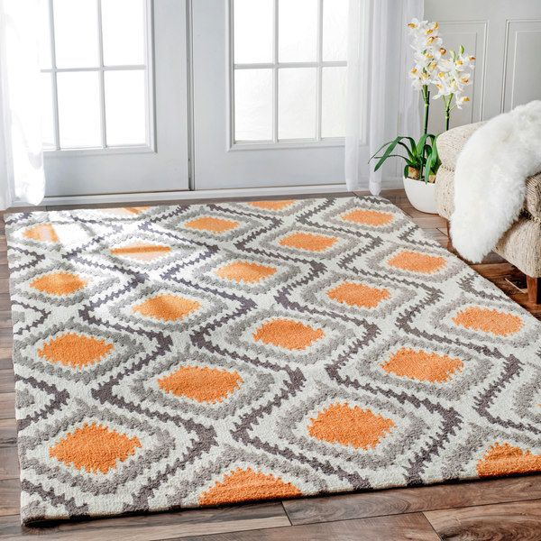 Quality meets value in this beautiful modern area rug. Hand-hooked with polyester to prevent shedding, this plush area rug will enhance any home decor. Primary materials: 100-percent polyester Latex: