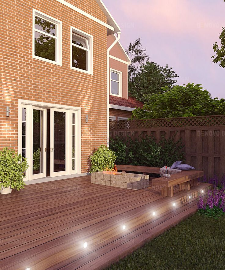 Open wood deck with fireplace. Material: Ipe wood and natural stone.