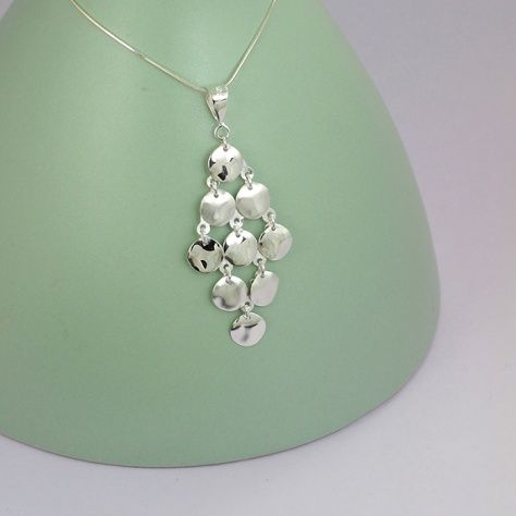 Waterfall Pendant £25.00 Stunning cascade of stirling silver coins that you can dress up or down All of our silver jewellery comes packaged in a pretty gift box. Sterling Silver 20 X 55 mm Comes with a 40 cm Silver Chain