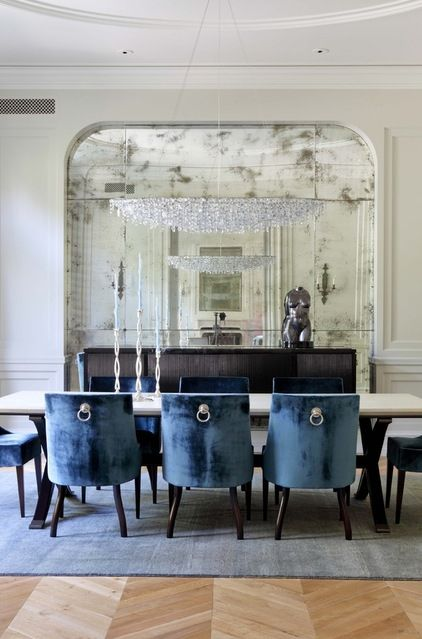 OBSESSED with this dining space. The mirror, the chandelier, & especially the lion head chairs. Obsessed. <3