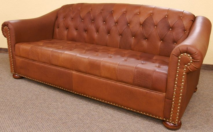 Camel tufted leather sofa. So chic.
