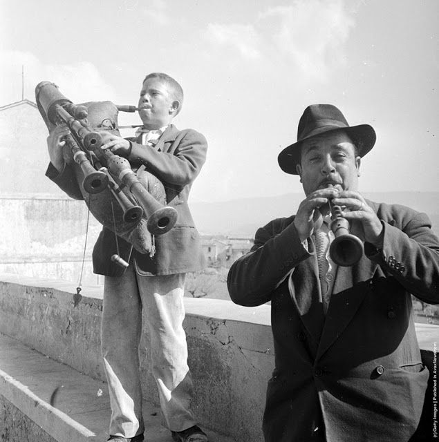 Two musicians play instruments in Calabria, southern Italy. Circa 1950.