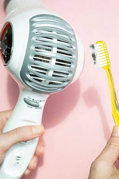 Clean the vent on your hairdryer with a toothbrush