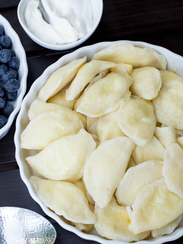 "Vareniky are dumplings that are filled with sweet or savory filling. The name varenyky, simply means ""boiled things"". Vareniky are part of the national Ukrainian food, just like (recipe/55). There are many restaurants in Ukraine that are serving Vareniky, they come with a wide variety of either savory or sweet fillings. The process may look endless, but its well worth your time. Uncooked Vareniky can be stored for several months in a freezer."