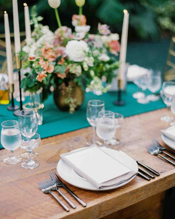 """This Couple's Miami Wedding Had an """"Old Florida"""" Vibe   Martha Stewart Weddings - The couple served a family-style meal of Tucsan and Southern cuisines on tables with peach and white floral centerpieces, and green velvet table runners. #weddingideas #weddingflowers #weddingcenterpieces"""