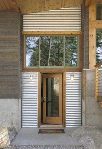 Corrugated galvanized tin and wood siding.