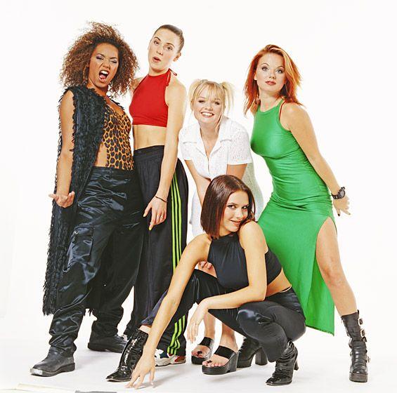 "The Spice Girls - Melanie Brown (""Scary Spice""), Melanie Chisholm (""Sporty Spice""), Emma Bunton (""Baby Spice""), Geri Halliwell (""Ginger Spice""), and Victoria Beckham, née Adams (""Posh Spice"")"