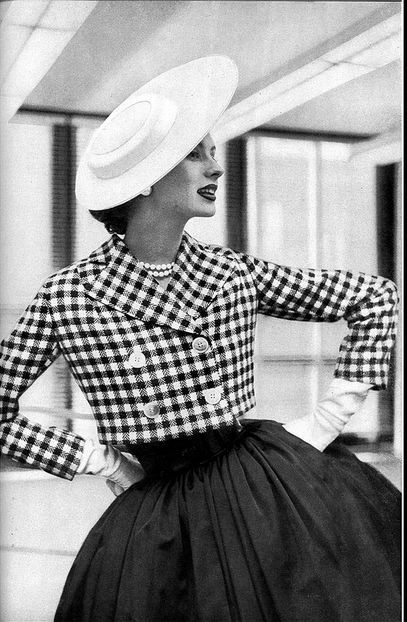 1952 Suzy Parker in short black & white check jacket over full skirt by H & E Shapiro, Vogue.