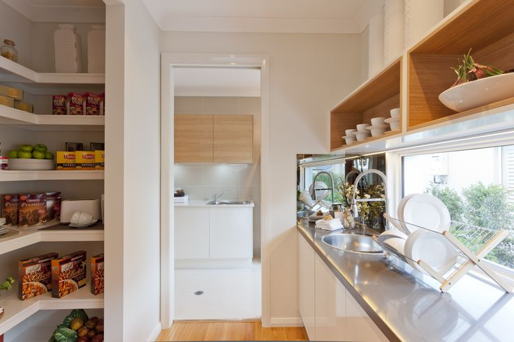 The clever inclusion of a Butler's Pantry complements any Gourmet Kitchen. With additional storage, Caesarstone benchtops and a stainless steel sink, the Pacific Butler's Pantry is both functional and stylish. Learn more at http://www.mcdonaldjoneshomes.com.au/home-designs/queensland/pacific #butlerspantry #butlerspantryideas #mcdonaldjoneshomes