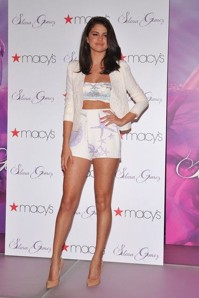 Selena Gomez attended the launch of her new perfume at Macy's in N.Y.C wearing this sensational, seashell printed Versace separates ensemble. Her look featured a tummy baring bandeau top and high-waisted shorts that she topped with a cropped Vanessa Bruno blazer.    The young star completed her look with Guiseppe Zanotti nude heels and large gold hoop earrings.