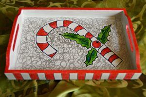 Use white paint and ordinary pens to turn a simple tray into a special DIY Christmas tray. #FaveCrafter