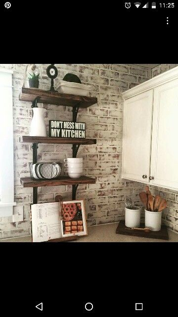 Faux brick paneling painted with chalk paint, then distressed with sander. Perfect, inexpensive backsplash with character