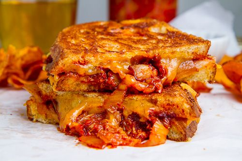 Kimchi and Bacon Grilled Cheese Sandwich - We could totally make it with veggie bacon if it means I get to eat it.